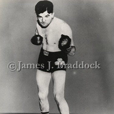 Braddock puts on the gloves for this publicity photo.