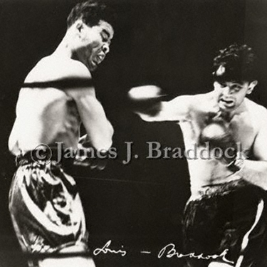 Joe Louis receives a solid right hand from Braddock