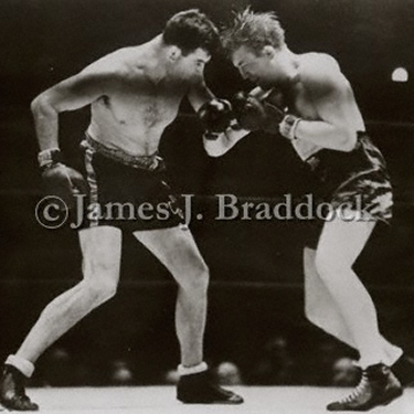 Braddock delivers a body blow to Tommy Farr
