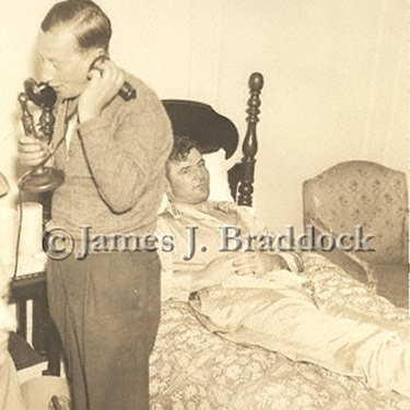 Manager Joe Gould answers phones while Braddock rests after a fight