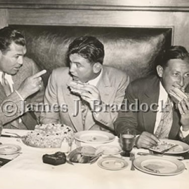 At Dempsey's restaurant NYC, Jack Dempey gives Jim advice for his upcoming fight with Max Baer