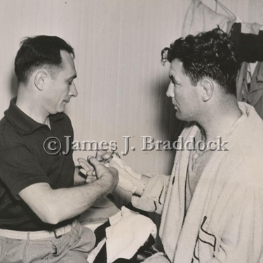 Doc. Robb cuts the tape off Jimmy's hands after a fight.