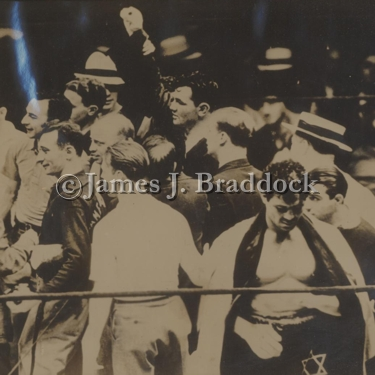 James J. Braddock celebrates winning the Heavyweight Championship of the World as Max Baer hangs his head in defeat. June 13, 1935 Long Island City.