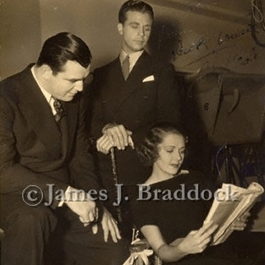 Jim looks over movie scripts with Dick Powell and Ruby Keeler