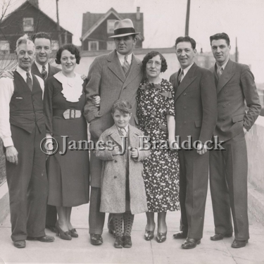Left to right: Father Peter Fox, son Peter, Daughter Mae(the champs wife), James J. Braddock, child Raymond Beck, Mother Mary Fox, and sons Harry and Raymond Fox.