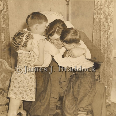 James Braddock plays with his children, Rose Marie, Howard and James