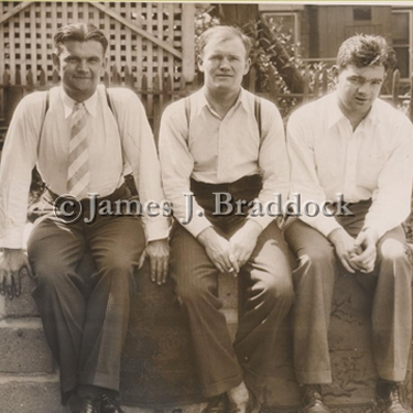 Jim Braddocks' brothers at their home in Guttenburg: Ralph, Joe Jr., and Al. 6/14/1935
