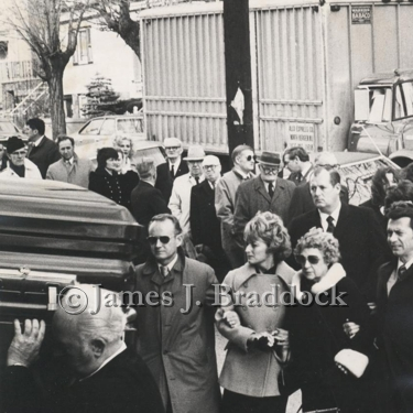 James J. Braddock's funeral at St. Josephs' in West New York. Up front is Kenny and Rosemarie DeWitt with Mrs. Braddock and son Jay behind. 1974.