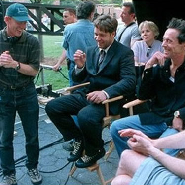 Director Ron Howard, Russell Crowe, and Producer Brian Graizer on the set of Cinerella Man. Toronto. 2004.